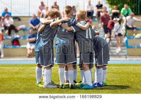 Children's Football Team on the Pitch. Boys in Grey Soccer Jersey Shirts Standing Together on the Football Field. Motivated Young Soccer Players Before the Final Game of School Tournament