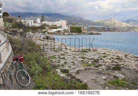 Old fisher bike near Balcon de Europa a rocky peninsula once supporting a castle Nerja Spain