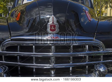 MOSCOW RUSSIA - OCTOBER 1 2016: Fragment of the front of the old Soviet car ZIM (GAZ-12) - the radiator grille and logo on the hood.
