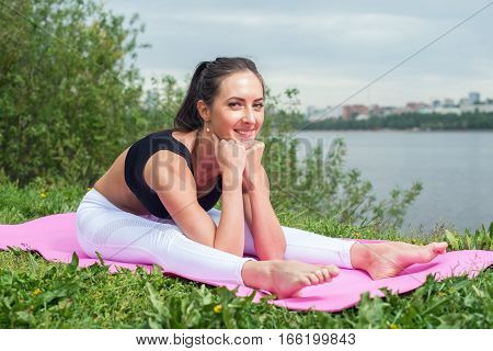 Fitness woman stretching back, hamstring leg muscles Seated forward bend
