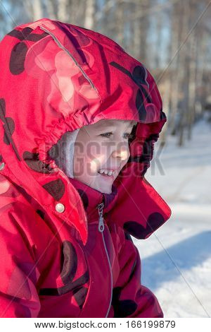 child in the bright jacket in the winter