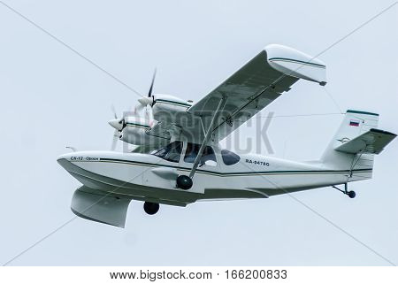 Tyumen, Russia - August 23, 2008: On visit at UTair airshow in Plehanovo heliport. Russian hydroplane SK-12 Orion flying in air