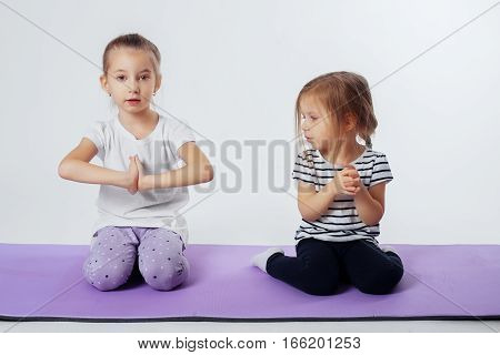 Little kids involved in sports. The concept of sport and a healthy lifestyle.
