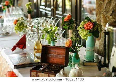 The wedding buffet table and flowers in vases