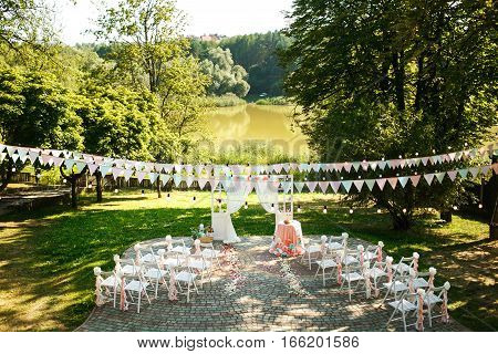 The wedding ceremony in the summer forest