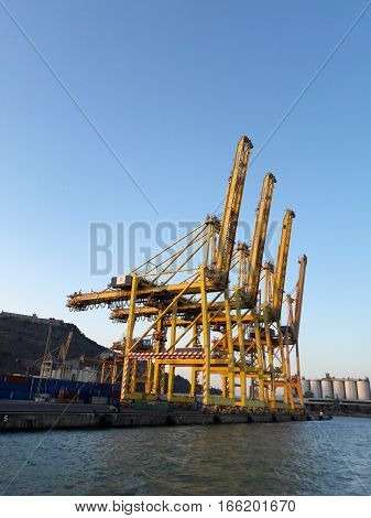 BARCELONA SPAIN - 09.28.2016: Shipping docks and shore based cranes at city port
