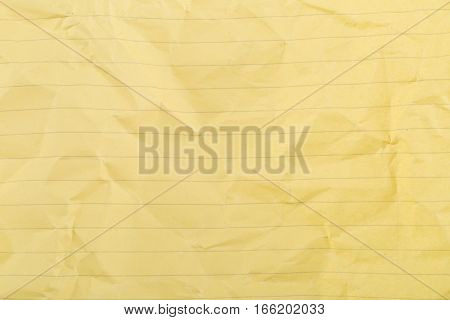 Crumbled yellow lined clean paper texture background