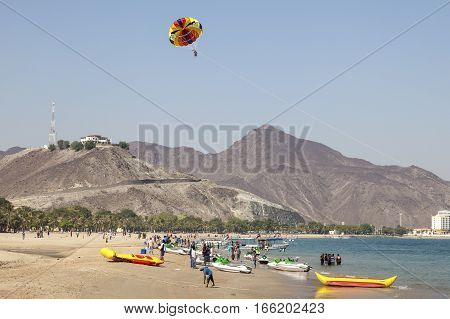 KHORFAKKAN UAE - DEC 1 2016: Parasailing on the beach in Khorfakkan Emirate of Sharjah United Arab Emirates