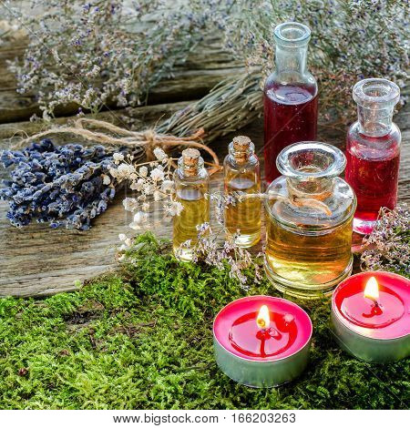 Bunch Of Dry Lavender, Candles And Bottles Of Scented Oil.