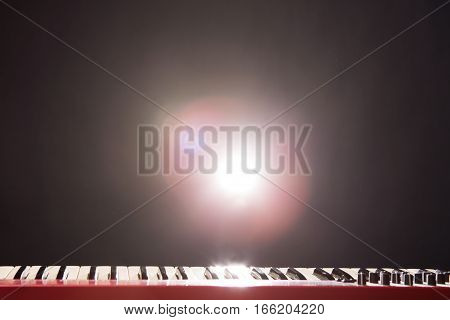 Microphone and piano in the dark background