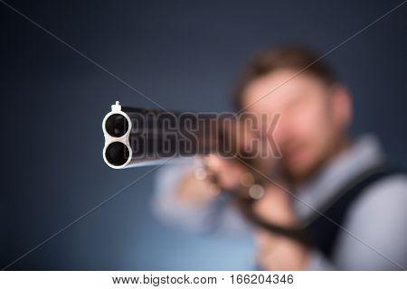 Office Worker Holding A Shotgun