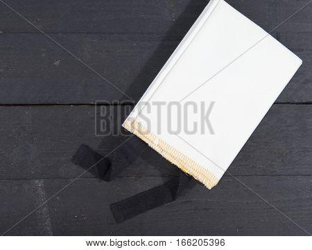 White fireblanket on a dark wooden background