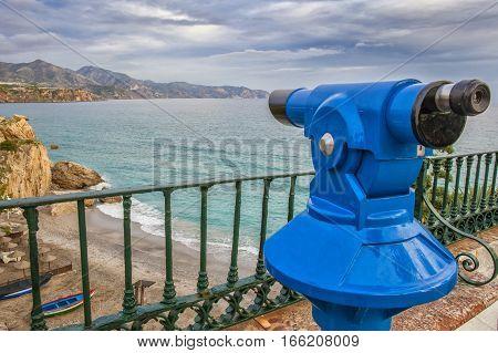Tourist telescope pointing to Calahonda beach at Balcon de Europa Nerja Spain