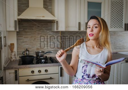 Young Woman Is Cooking
