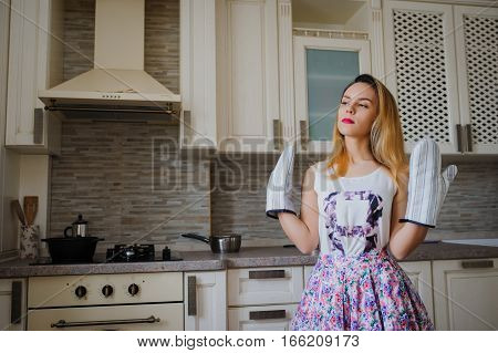 Happy Housewife With Oven Gloves