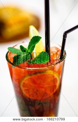 A Sprig Of Mint Close-up On Red Cocktail.