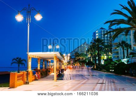 Night Scenery View Of Embankment In Benalmadena. Benalmadena is a town in Andalusia in Spain, 12 km west of Malaga, on the Costa del Sol. It caters for a large number of tourists.