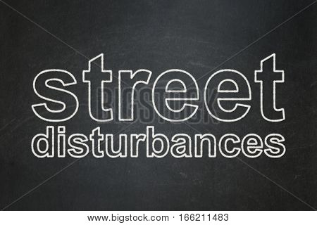 Politics concept: text Street Disturbances on Black chalkboard background