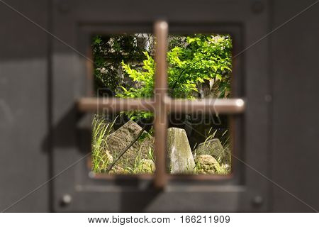 Old Jewish Cemetery Through Gridded Window In Prague, Czech Republic