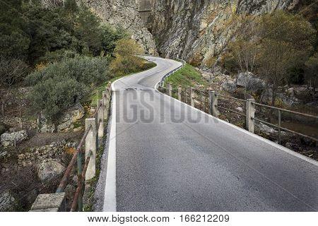a paved road at Barragem de Santa Luzia dam, Pampilhosa da Serra municipality, Coimbra District, Portugal