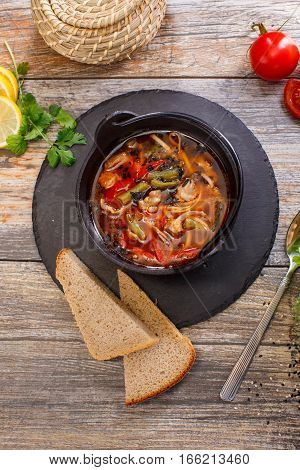 Hot Goulash Soup In A Black Pot