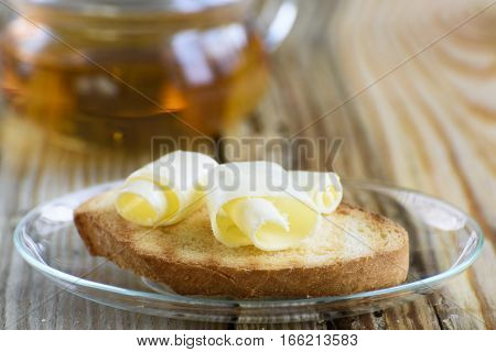 Toast with butter curl for breakfast. Close up