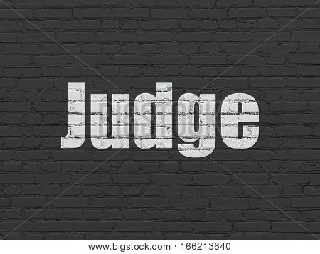 Law concept: Painted white text Judge on Black Brick wall background