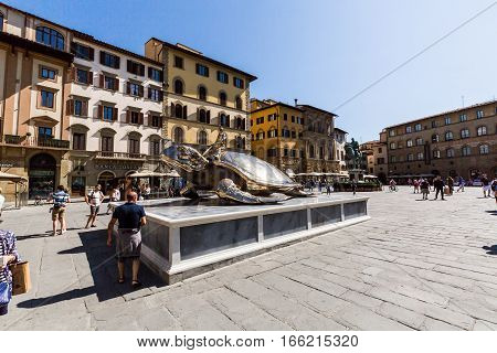 View Of The Piazza Della Signoria And An Art Installation With A Golden Turtle