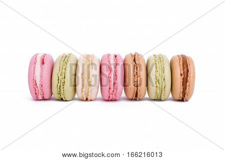 Row Of Sweet Colorful French Macaroons Or Macaron Biscuits Isolated On White Background
