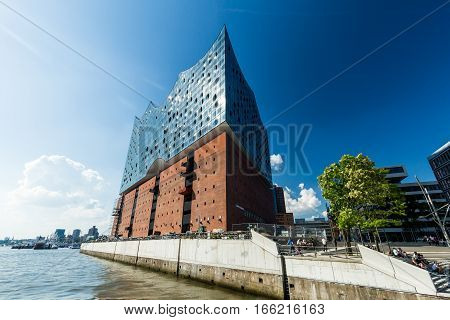 HAMBURG GERMANY - JUNE 4 2016: The Elbphilharmonie building in the port of Hamburg on June 4 2016. It is Germanys largest port and is named the countrys Gateway to the World.
