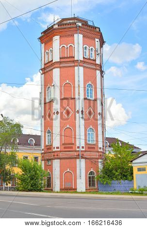 Old water tower in Vologda at sunny day Russia.