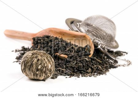 tea strainer with a wooden shovel isolated on white background.