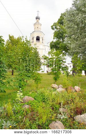Flowerbed in Saviour Priluki Monastery by cloud day near Vologda Russia.