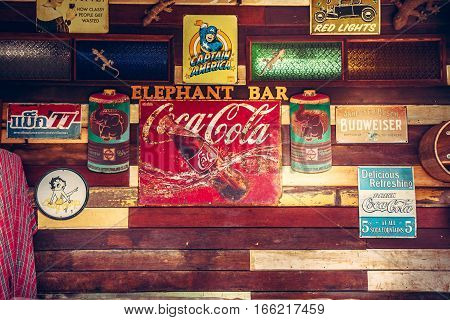 Koh Samui, Thailand - 30 june 2016: Vintage style old fashioned bar counter wooden wall with retro signs and signboards at cafe in Fishermans village in 2016