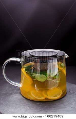 three square teapots with different colors fruit tastes of tea