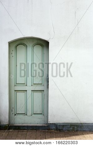 old wooden door in a stone wall house