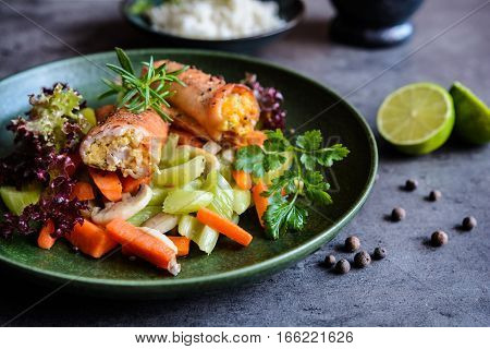 Roasted Turkey Breasts Rolls Stuffed With Egg, Feta Cheese, Pepper And Parsley, Served With Rice And
