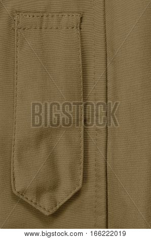 Coyote Tan ECWCS Parka Rank Insignia Badge Loop Closeup, Blank Empty Vertical Apparel Background Copy Space, Front Placket Storm Flap, Large Detailed Macro