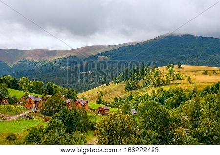 Beautiful small village Surrounded by mountains and forests cloudy summer day in Carpathians