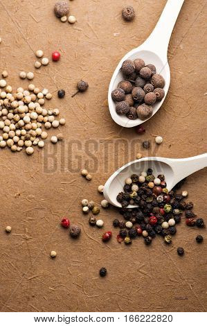 Mixture of peppers: hot, red, black and white pepper background