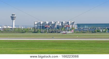 Munich Germany - May 6 2016: Panoramic view of Munich international airport is named in memory of Franz Josef Strauss with passenger jet plane of Austrian Airlines.