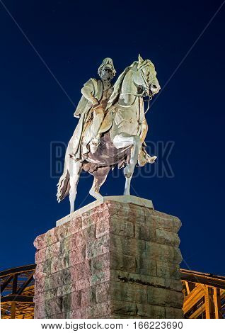 Cologne, Germany - January 19, 2017: Equestrian statue of Prussian King Wilhelm I. Friedrich Ludwig. Located at the Hohenzollern Bridge. Night photo.
