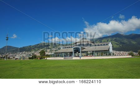Quito, Pichincha / Ecuador - January 22 2016: View of the Crystal Palace in the Ichimbia park with the city of Quito in background