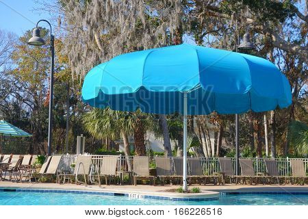 giant poolside umbrella on a sunny day