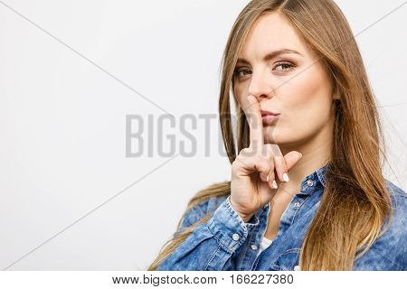 Lady Putting Finger To The Mouth.