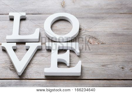 Love and still life concept. Valentines day holiday letters text message card. Copy space background