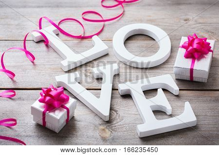 Love and still life concept. Valentines day holiday letters text message card with gift boxes