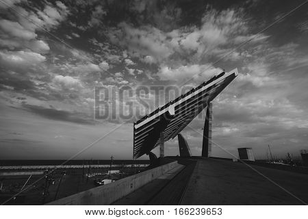 Modern solar power station in Forum district area on sunset next to sea Barcelona Spain wide angle shoot with beautiful sky and clouds