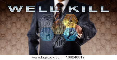 Torso of a male business manager in blue suit activating WELL KILL on an interactive virtual control monitor. Oil and gas industry technology concept and petroleum production technical terminology.