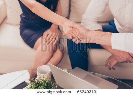Close up of woman in formalwear handshake with business partner